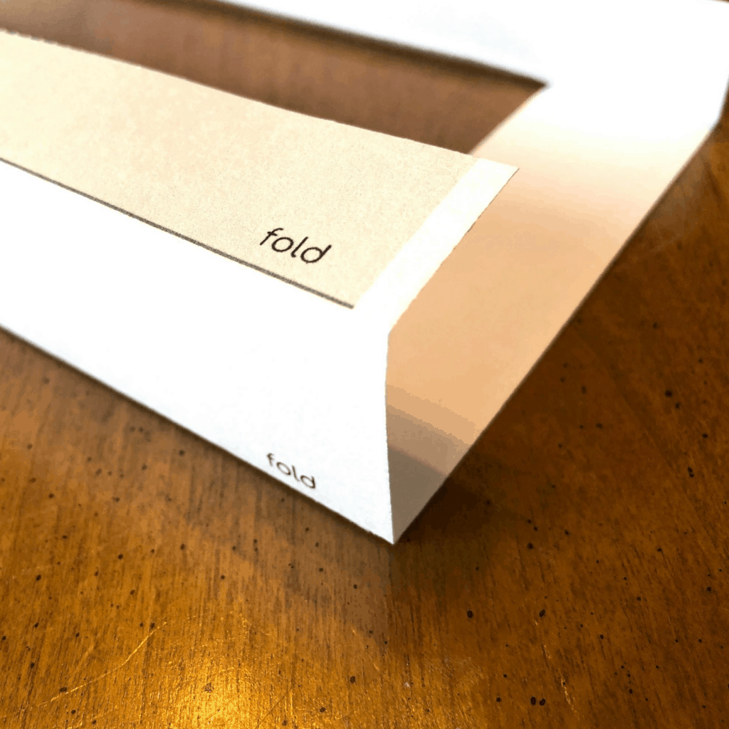 close up of the word fold on a piece of paper indicating where to fold it
