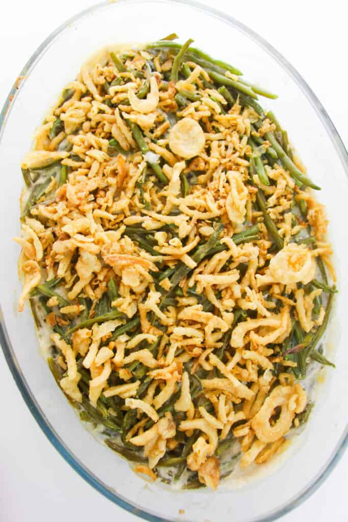 a casserole dish with green beans topped with french fried onions