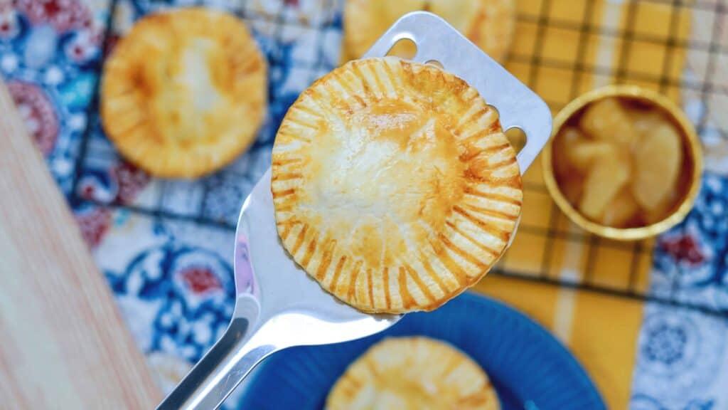 A close up of a mini apple pie
