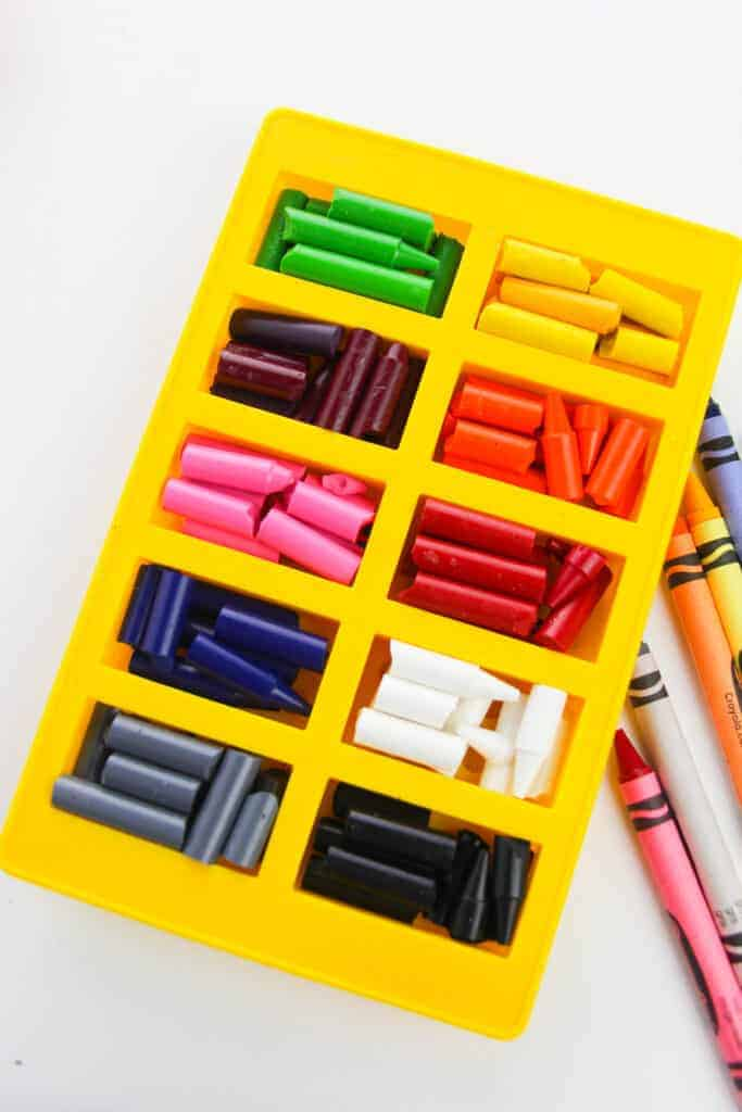 Crayons broken down and organized by color. Each color is in their own mold.