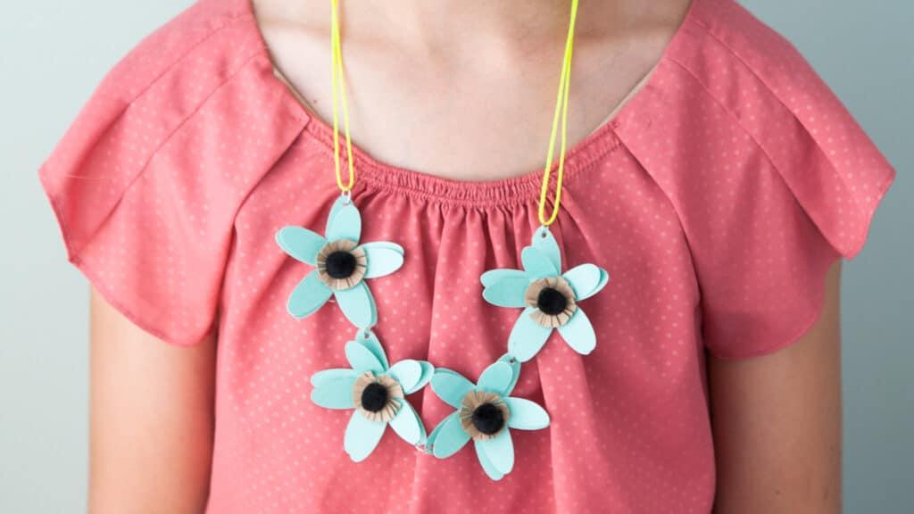 Flower heart around little girl's neck.