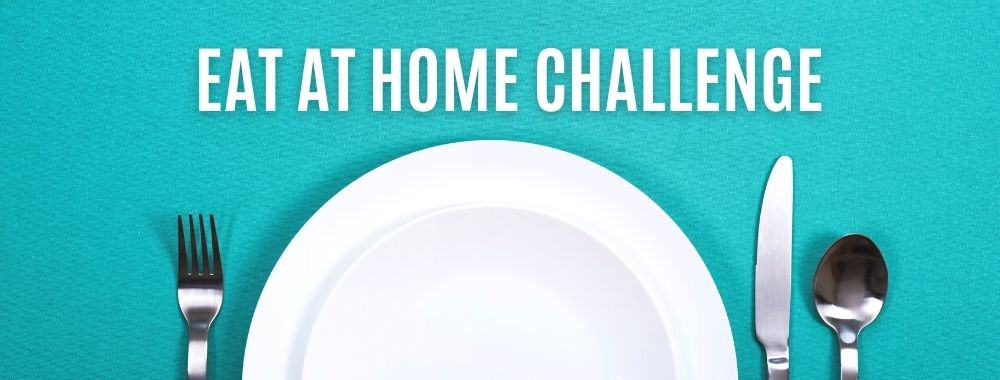 Empty white plate with fork, knife, and spoon for an eat at home challenge.