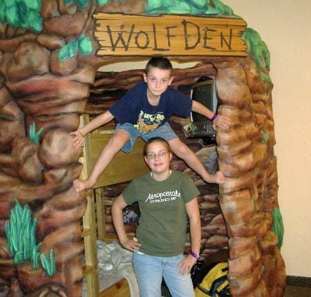 Wolf den play area with kids standing outside.