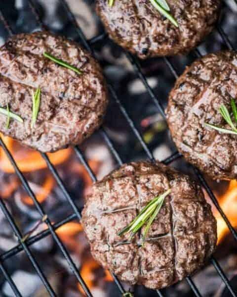 Grilled hamburger patties on a bbq.