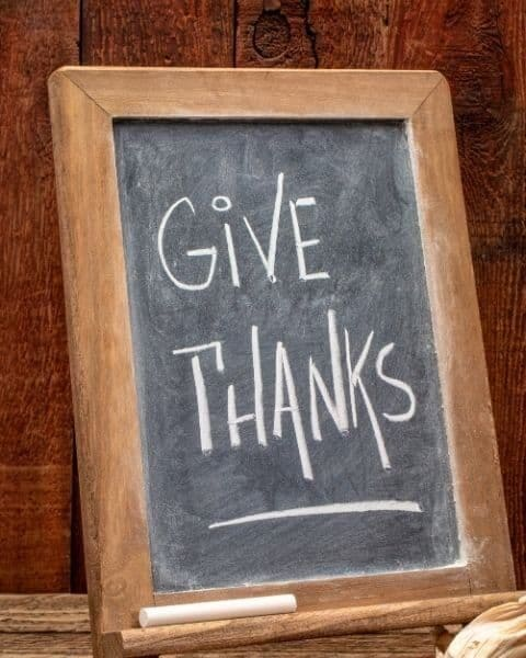 """A sign that reads """"Give Thanks""""."""