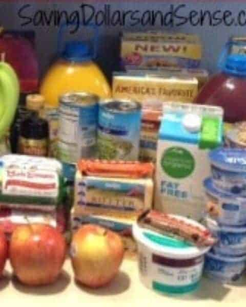 A variety of groceries from produce, juice, milk, yogurt, and more on the kitchen counter.