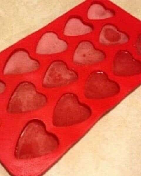 Silicone cup holders with gummy heart shaped candies.
