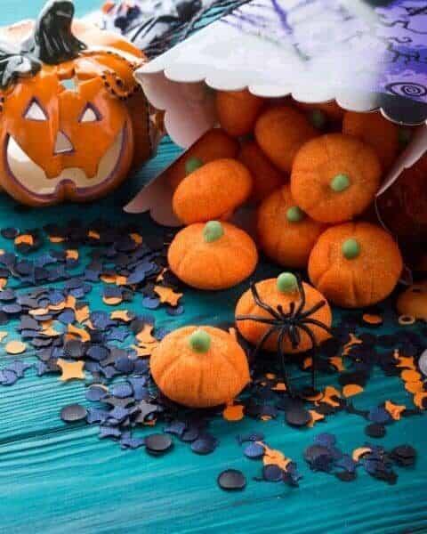 Halloween pumpkin decorations including spiders.