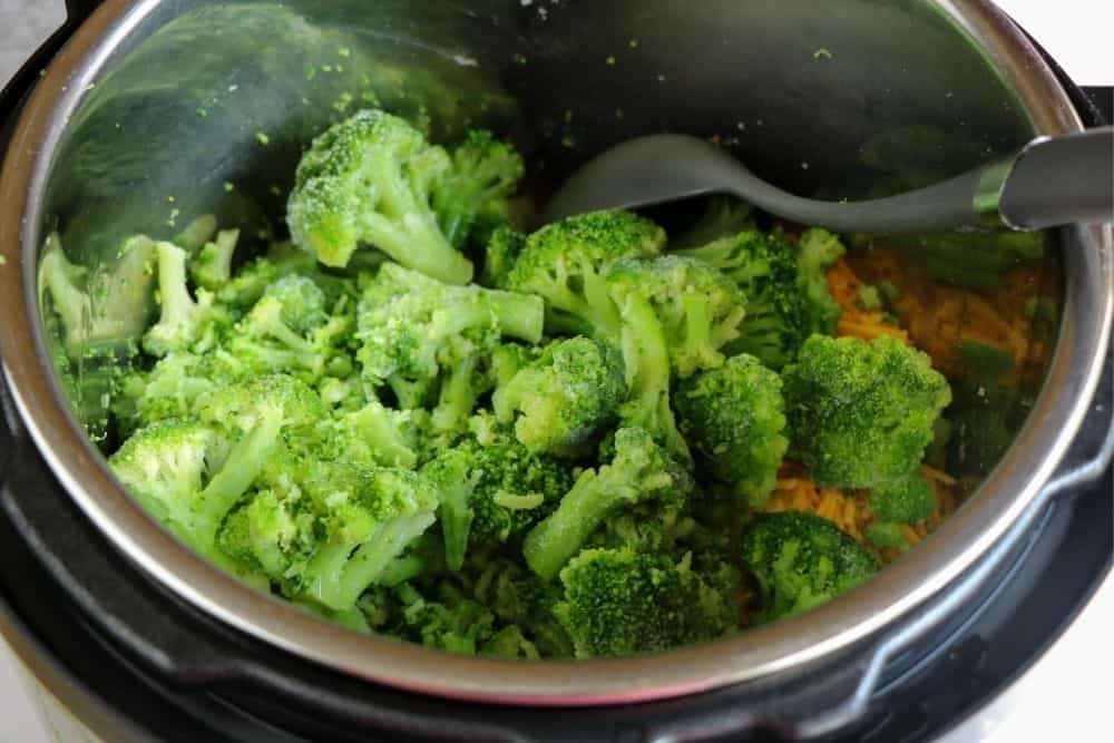close up on broccoli inside a pressure cooker.