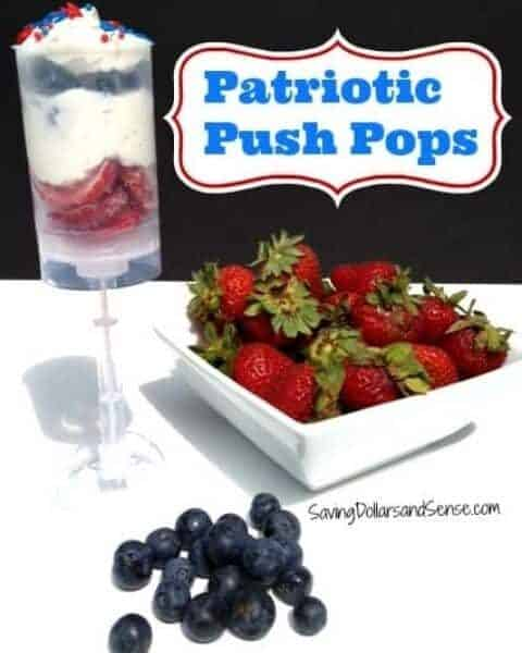 Homemade push pops with strawberries, whip cream, and berries.