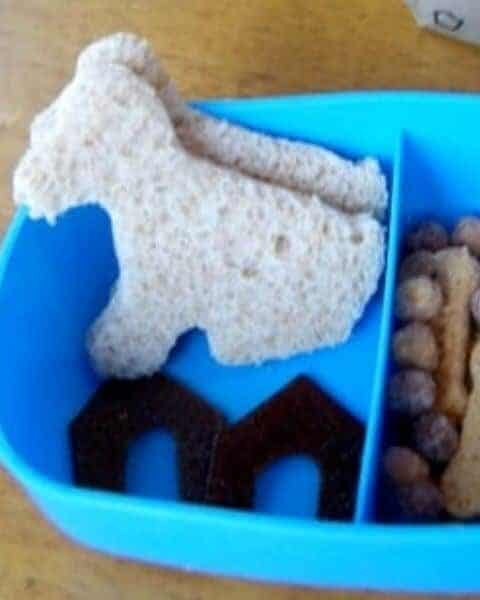 Bread cut out in the shape of dogs for a puppy themed lunch.