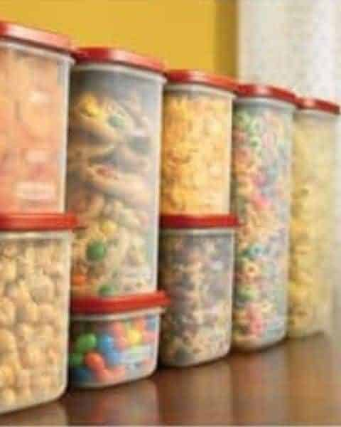 A variety of tupperware sizes full of homemade treats, cereals, and other food.
