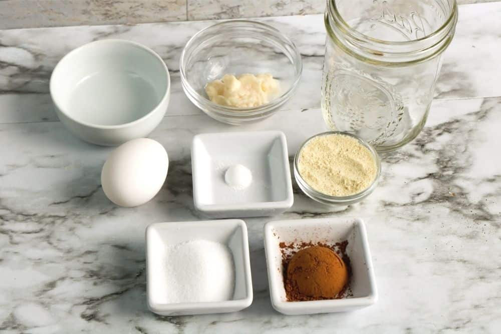 Chocolate Keto Cake ingredients including: water, egg, monk fruit, baking powder, almond flour, cocoa, and mayo.