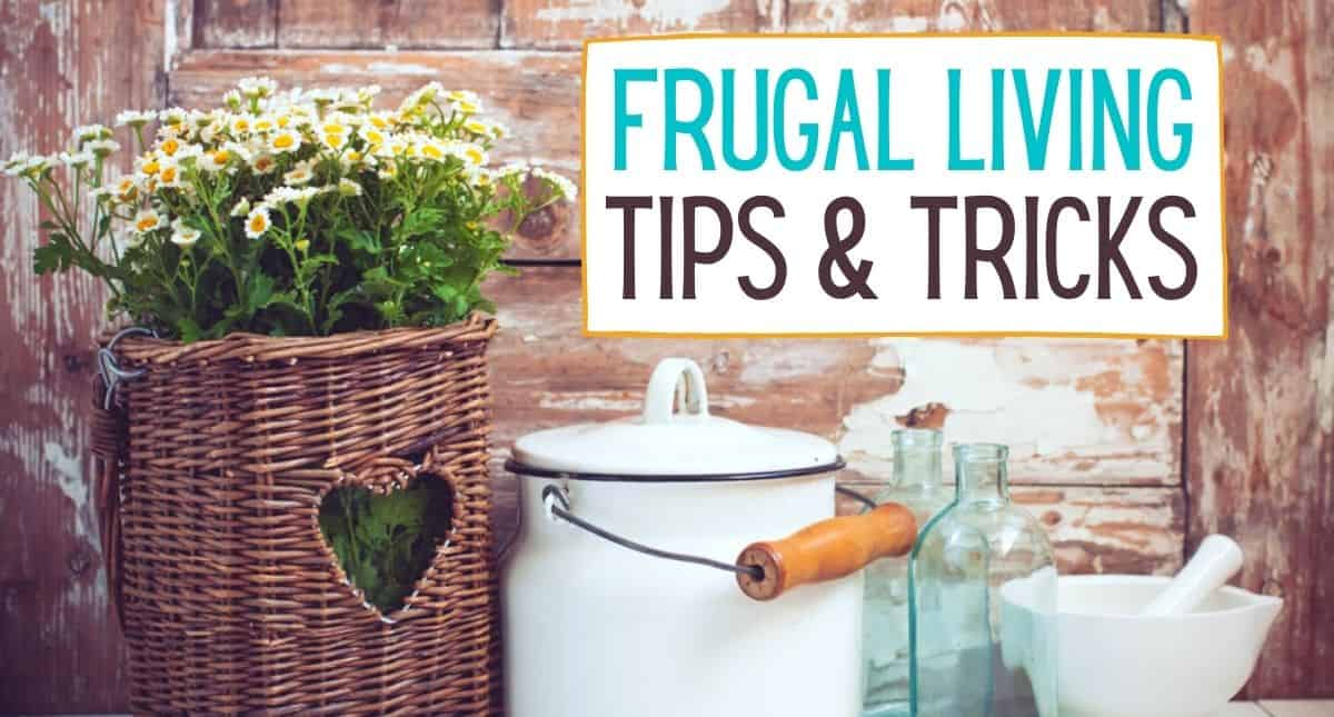 Photo of a basket filled with flowers, a white caniter and a couple glass bottles sitting on a countertop with the words Frugal Living Tips & Tricks
