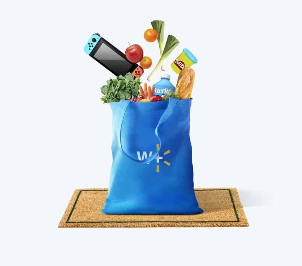 A blue Walmart Plus bag filled with groceries, a game system and toys.