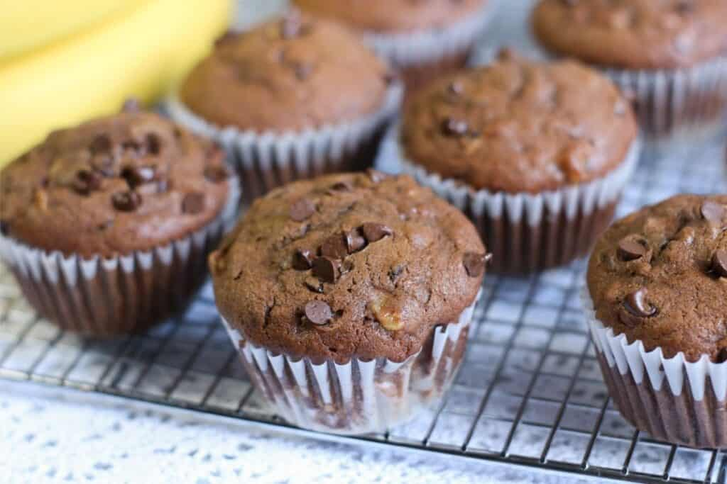 chocolate chip muffins sitting on a cooling rack.