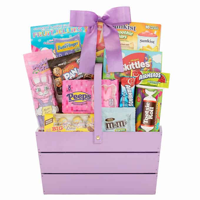 Purple wooden basket with happy Easter treats.