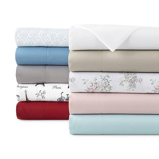 Stack of folded bedsheets;