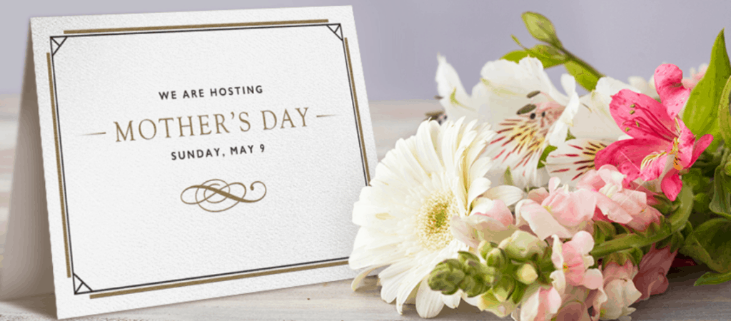 Mother's Day sign next to a bouquet of flowers.
