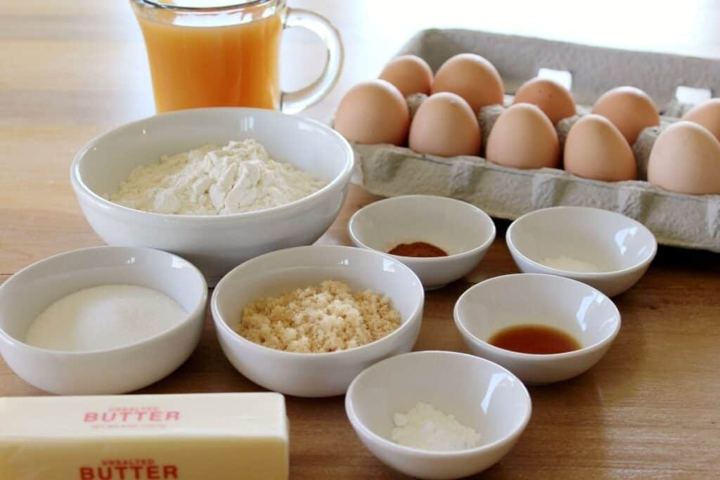 A variety of ingredients including eggs, flour, sugar, apple cider, butter, and more.