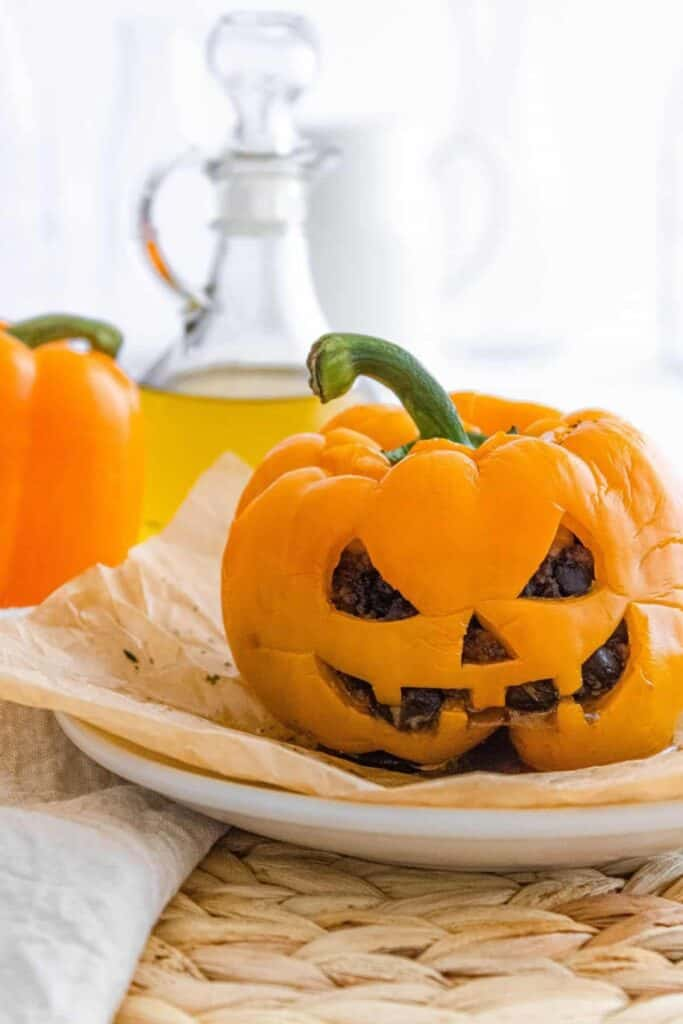Cooked bell pepper that looks like a jack-o-lantern.